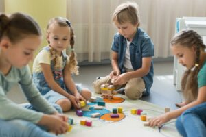 front view children playing together kindergarten 300x200